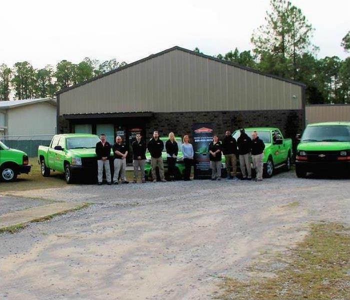 Group from SERVPRO of North Pensacola in front of their SERVPRO warehouse.
